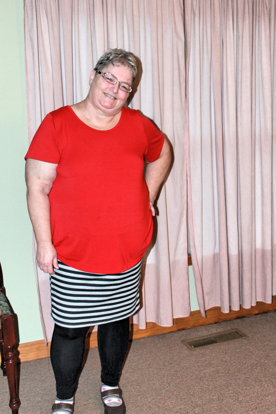 This outfit is a Classic Tee, a Cassie Skirt, and leggings.