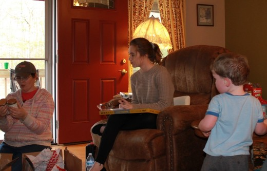 My granddaughter, Sarah B., watching her step-mother Sarah J open a gift. Parker standing nearby..