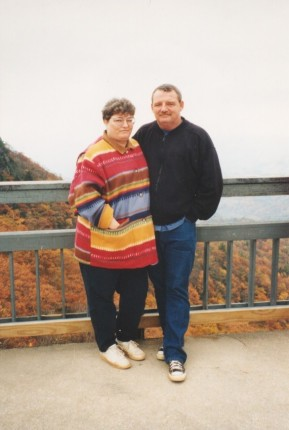 Me and my husband when I was younger. Notice the ong jacket to cover up my pants.