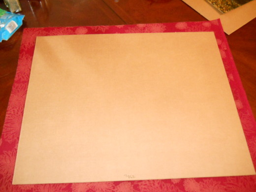 Cut the fabric about two inches larger than your cardboard