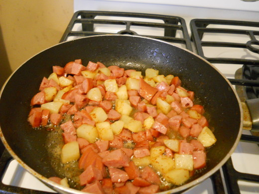 Cook potatoes and sausage together for about five minutes