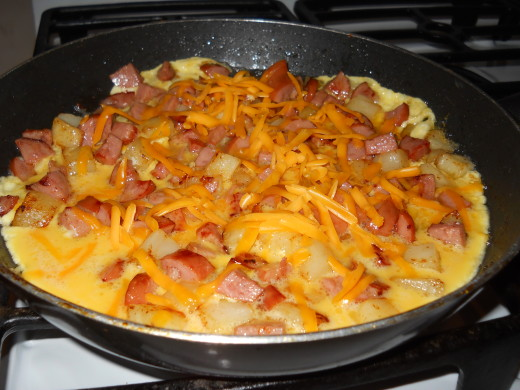 Sprinkle with cheese, then cover and let cook until eggs are done to your taste