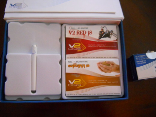 v2 e-cig kit with Red and Sahara flavor cartridges