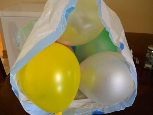 Put the balloons in a large plastic bag.