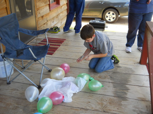 Popping the balloons on the porch