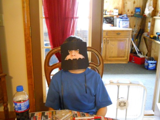 Spencer in his Batman mask.