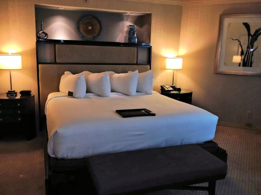 The bedroom of the Presidential Suite has a huge king bed.