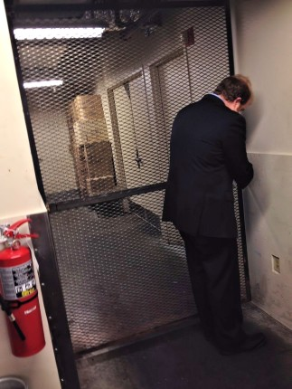 Assistant Beverage Manager Alex Thornton unlocking the gate to the liquor vault.