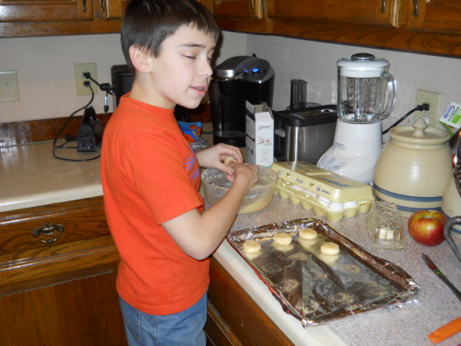Spencer making Glutino Sugar Cookies on our craft day in December