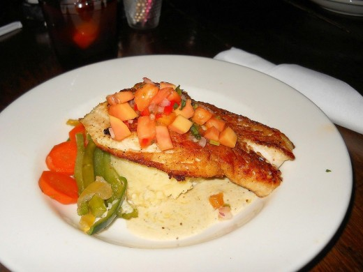 Pan Seared Red Snapper with Smashed Potatoes and grilled vegetables.