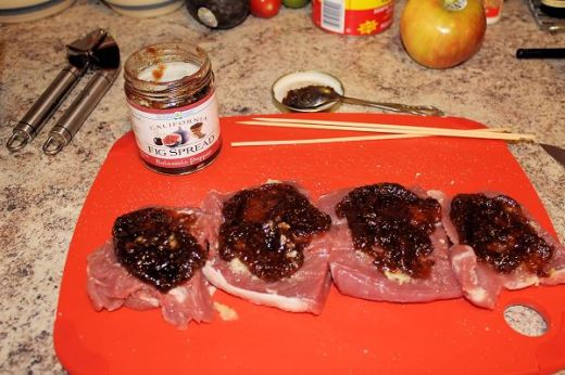 Spread each piece of meat with minced garlic and fig spread.