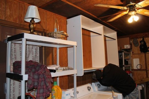 WoodTrac Hanging Half Closet Organizers installed over my laundry machines.