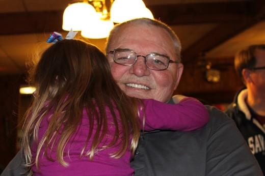 Poppa holding his girl, Amelia