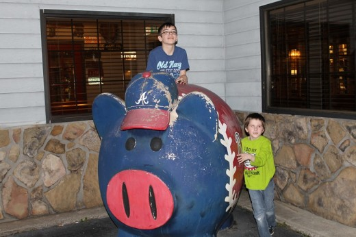 Cousins: Spencer and Owen with the pig
