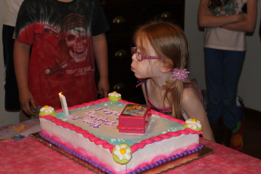 Granddaughter, Amelia, blowing out her candles on her 5th birthday, May 24.