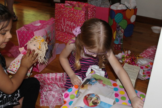 Opening presents was a fun time! Here she is opening the puppet theater that we gave her.