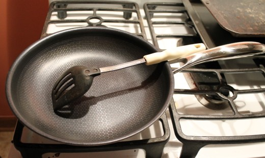 I use a nylon spoon but you can use metal with this pan.