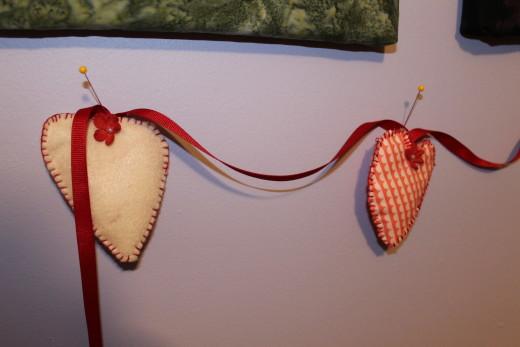 Closeup of one of the felt hearts.