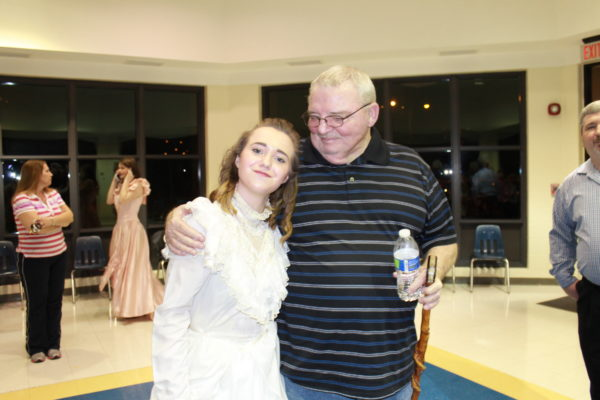 With our granddaughter, Sarah at her school play last year.