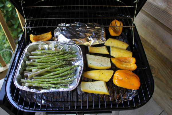 cooking asparagus on a charcoal grill