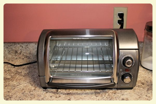 Easy Reach 4 Slice Toaster Oven With Roll Top Door by Hamilton Beach