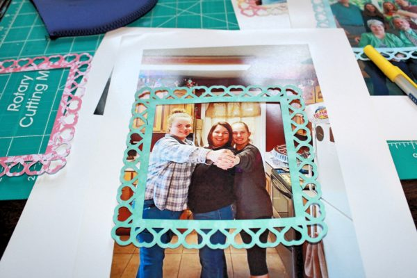 Cut the photos to fit the frames I cut out with my cutting machine.