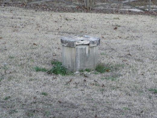 Concrete well head in the yard