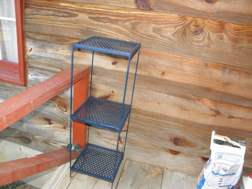 A metal shelf for the porch