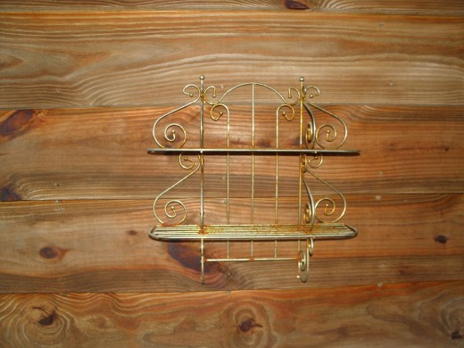 A rusted decorative shelf for the front porch