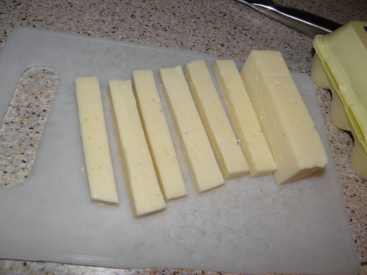 Cut the cheese into strips about 1/4 inch thick.
