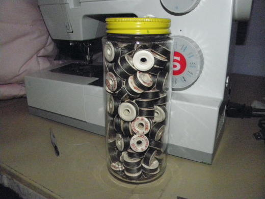 Jar of black bobbins