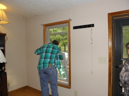 The new window set in the cutout, waiting to be screwed in and caulked.