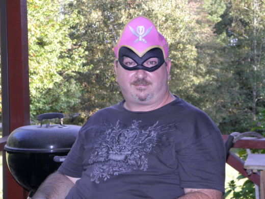 Daddy Tries out the Pink Power Ranger Mask. No potato powers for him, though.