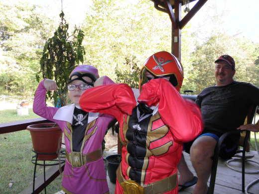 Owen disguised as Super Train Man, flexing his