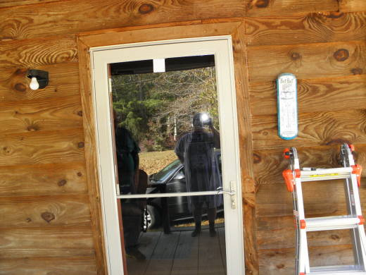 The new storm door has a hidden screen. You don't see it unless the top is open.