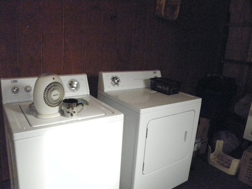 The washer and dryer are now back together again on the back porch.