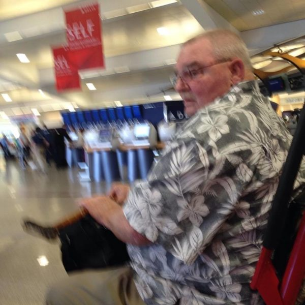 Fabgrandpa taking the wheelchair ride at the airport