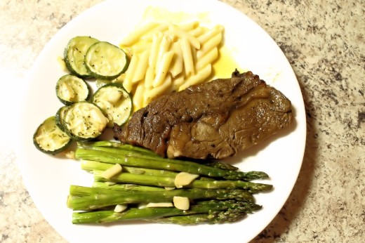 Asparagus & Zuchinni Bake served up with macaroni and cheese, and rib eye steak.